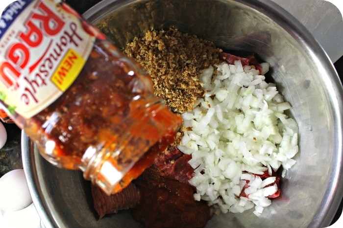 Italian meatloaf pouring sauce