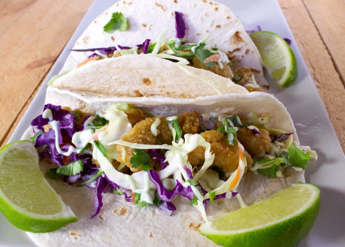 The best fish tacos recipe with wasabi garlic lime sauce for Suggestions for sides for fish tacos